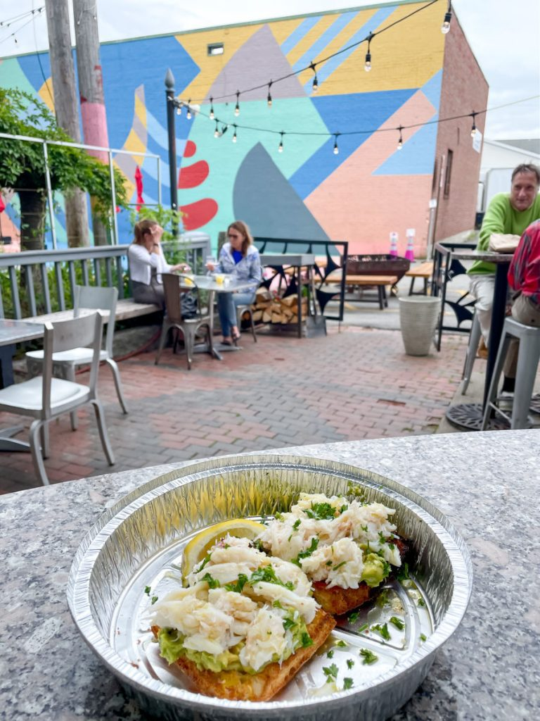 Crab toast on outdoor patio at Cafe Miranda