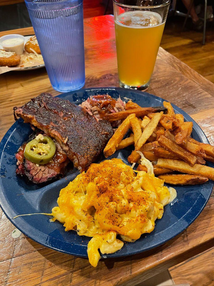 Ribs brisket mac and cheese and fries at Dinosaur BBQ in Syracuse NY