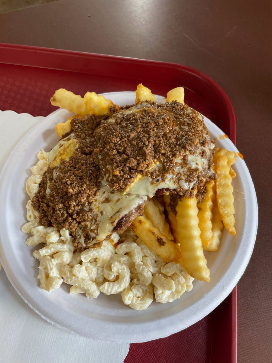 Garbage plate at Nick Tahou Hots with cheeseburgers, fries, and macaroni salad