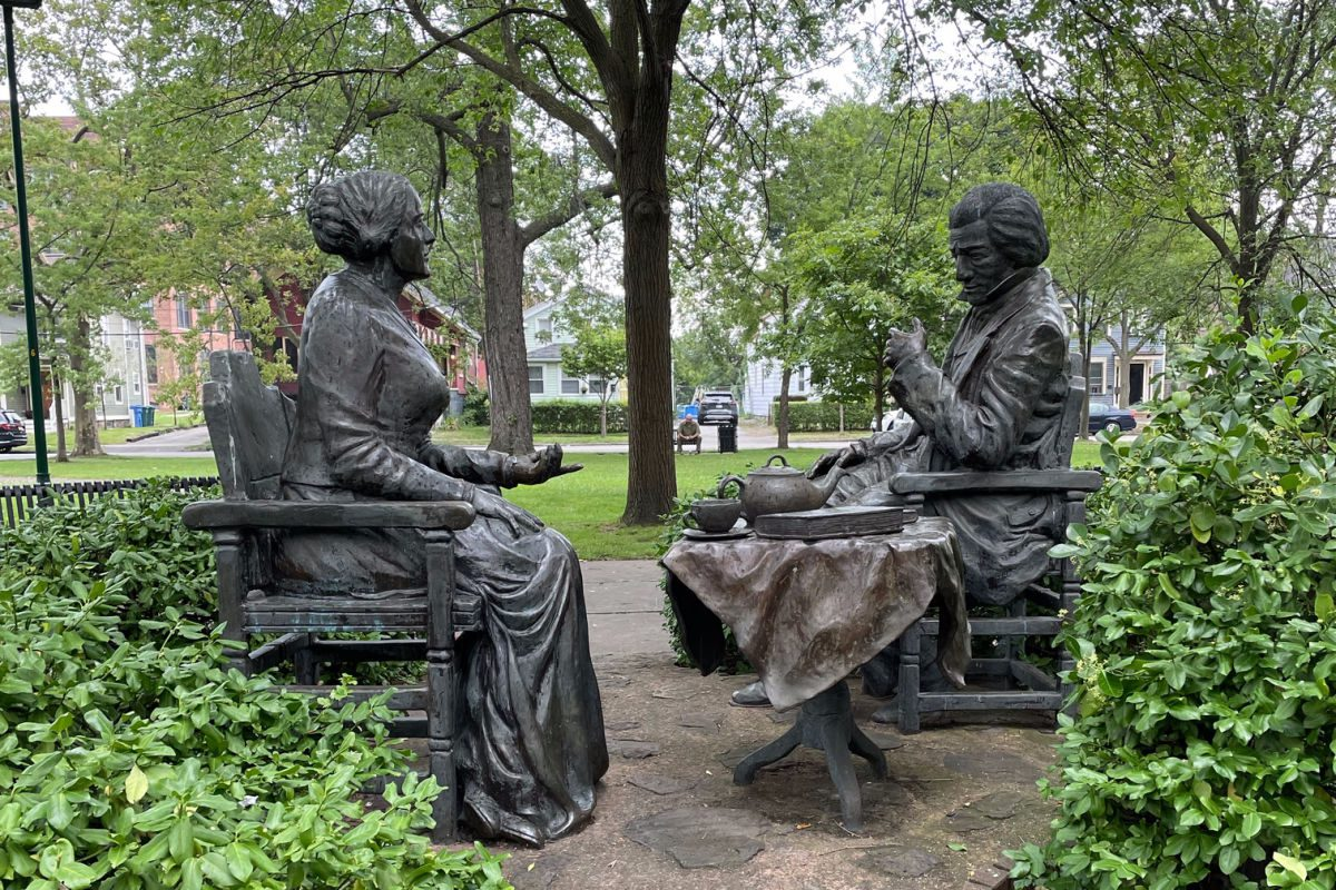 Susan B. Anthony and Frederick Douglass having tea statue in the park