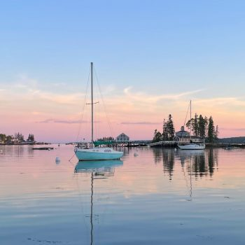Sailboat on the water in Boothbay Harbor at sunset