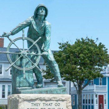 Fishermen's memorial and houses in downtown Gloucester MA