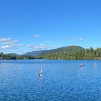 Paddle boards and kayaks on Mirror Lake new york