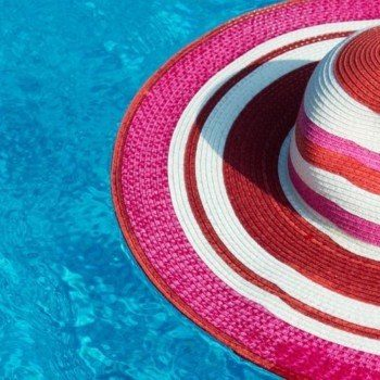Packable sun hat floating in water
