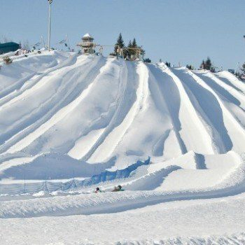 Snow tubing in Quebec at Villages Vacanes Valcartier was such a blast! Just 20 minutes outside of Quebec City it was perfect family fun for a winter trip with 35 snow tubing trails for every comfort level.