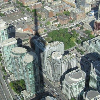 Looking down at the shadow of the CN Tower in Toronto