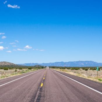 flat road in New Mexico heading towards mountains
