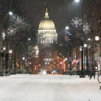 Wisconsin State Capitol building at night in the snow