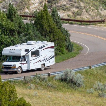 RV driving through bend in road in Theodore Roosevelt National Park